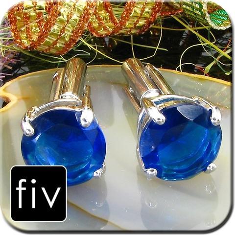 Manžetové gombíky striebornej farby s modrým kruhovým kryštálom